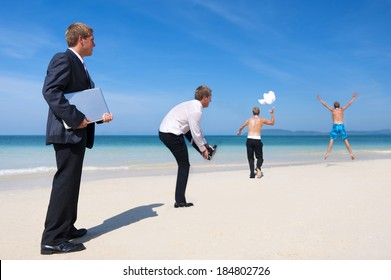 Businessmen Playing On The Beach