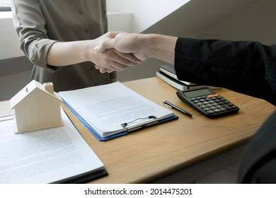 Businessmen present price contract on trading - rent a house to customers. Insurance Agent house. Business concept.