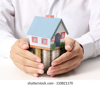 businessmen Protect Your House in hand
