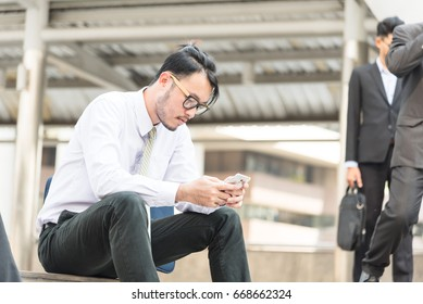 Businessmen sad about work in the city,business fail,sit,find jobs