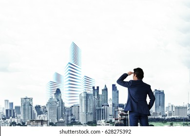 Businessmen see the future expansion of the city.