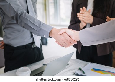 Businessmen shake hands after meeting.Business etiquette to congratulate mergers and acquisitions.
