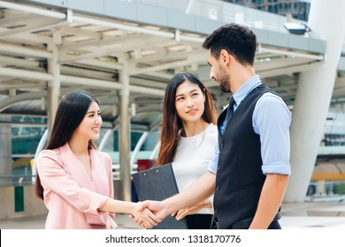 Businessmen are shake hands after negotiating a successful business deal with a smiling face in Bangkok, Thailand in the morning. Concept, agreement and business negotiation