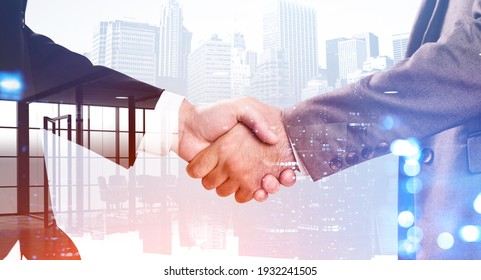 Businessmen shake hands, double exposure of office room and city buildings, night bokeh lights. Concept of international connection and teamwork