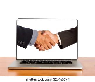 Businessmen shake hands in laptop screen.