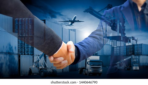 Businessmen are shaking hands to agree to a business deal Logistics Industrial Container Cargo. The concept of modern life, business, city life and internet of things.