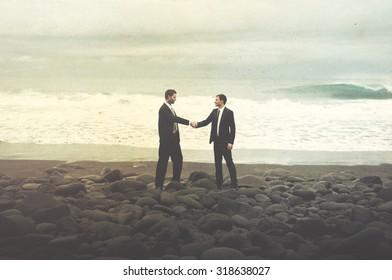 Businessmen Shaking Hands Beach Corporate Agreement Concept