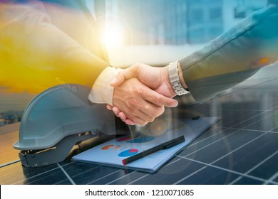Businessmen are shaking hands for business venture and Marketing on energy.Solar is needed in the future.Solar panels require expertise in installation.photovoltaics to the business sector.