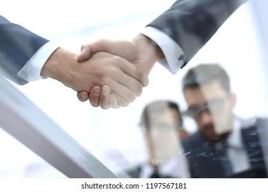 businessmen shaking hands closeup.business background