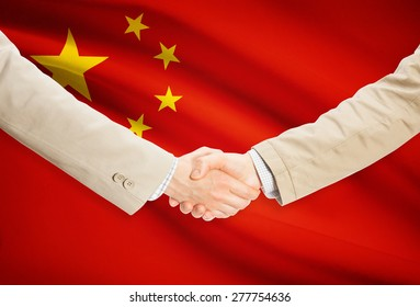 Businessmen shaking hands with flag on background - People's Republic of China