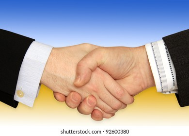 Businessmen shaking hands in front of the Solar Power Station