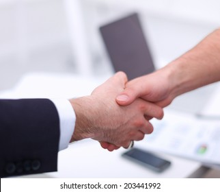 Businessmen shaking hands, isolated on white.