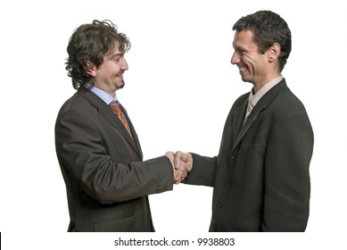 businessmen shaking hands - isolated over a white background