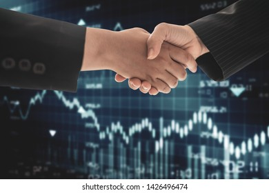 Businessmen shaking hands on blurred forex chart background. Teamwork concept. Double exposure