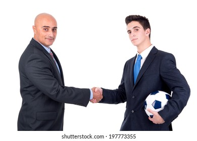 Businessmen shaking hands over a football match isolated in white