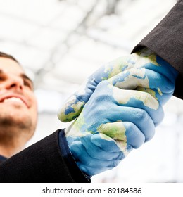 Businessmen shaking world painted hands