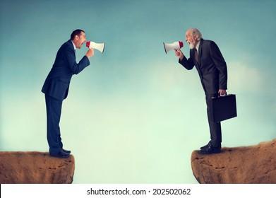 businessmen shouting through megaphones business conflict concept