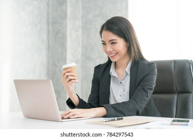 Businessmen smiled at coffee / tea and used the tablet computer at work. Modern Communications Concept
