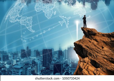 Businessmen stand on high peaks and look to the foreground cityscape, conceptual leader.