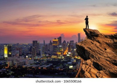 Businessmen stand on high peaks and look to the foreground landscape, conceptual leader.