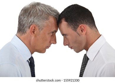 Businessmen stood head-to-head