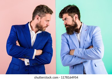 Businessmen stylish appearance jacket pink blue background. Tense face expression competitors. Business competition and confrontation. Business partners competitors in suits with tense bearded faces.