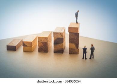 Businessmen talking about wood block step, Successive business concept.