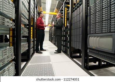 Businessmen talking in a datacenter room