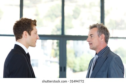 Businessmen talking to each other in an office