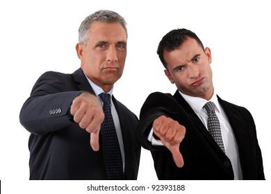 businessmen, thumbs down