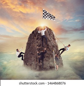 Businessmen try to reach the goal. Difficult career and conpetition concept.