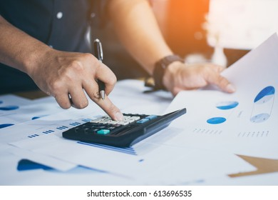 Businessmen use the calculator to calculate and analyze the comp
