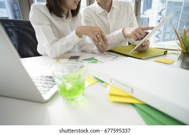 Businessmen use smart tablet to conference.