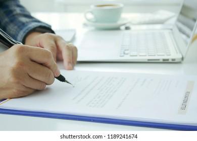 "Businessmen are using pens to "" Resignation letter"""