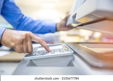 Businessmen are using photocopiers, scanning documents papers in Office.