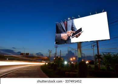 businessmen using tablet at meeting display on billboard with white space for advertising