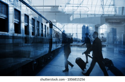 businessmen walking along a deserted railway station platform and getting ready to board a waiting passenger train , Transportation travel concept