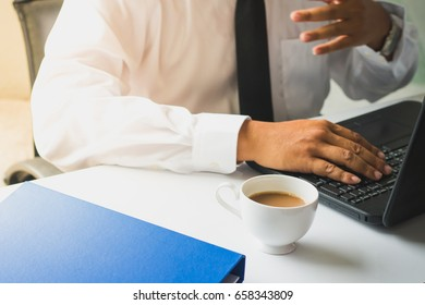 Businessmen who are committed to working with coffee in the morning.