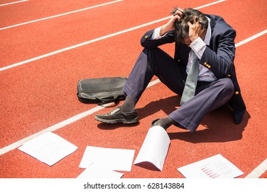 Businessmen who sit stressed because they are unsuccessful, disappointed and sad