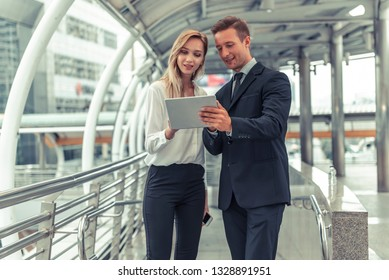 Businessmen & women looking forward his plan about investment on tablet
