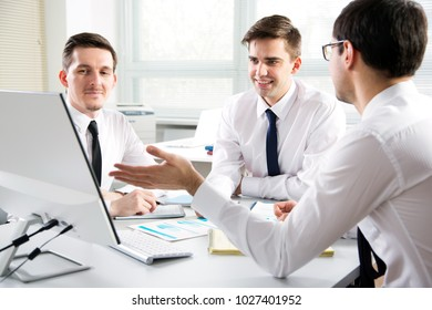 Businessmen working with computer in an office