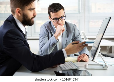 Businessmen working with compyter in an office