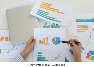 businessmen working with financial document and tablet