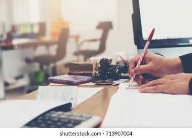 Businessmen are writing business accounting results in a account book,Business concept
