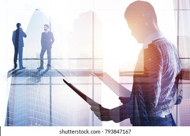 Businesspeople in abstract glass office interior with sunlight and city view. Meeting and contract concept. Double exposure