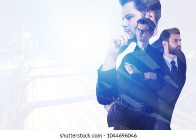 Businesspeople in abstract office interior with city view and daylight/sunlight. Meeting and management concept. Double exposure