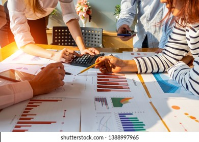 Businesspeople analyzing investment graph meeting brainstorming and discussing plan in meeting room, investment concept