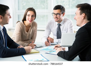 Businesspeople discuss a new project in the office