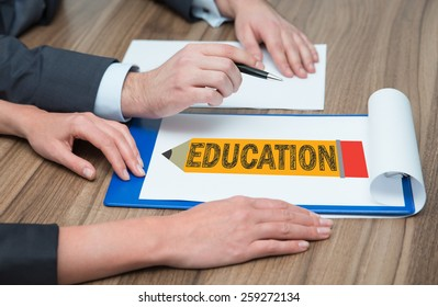 businesspeople drawing in clipboard education symbol