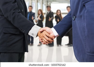 BusinessPeople Executive Handshake to show Partnership with Other with Businessman and Businesswoman Team Background as Business Matching or Business Partner or Business Greeting Concept